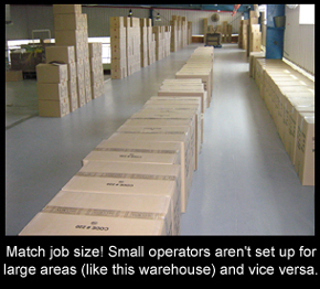 Resin flooring over a large warehouse floor with boxes stacked on it.